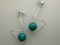 Swirl earrings with stone beads