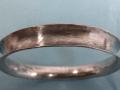 Hammered anticlastic bracelet