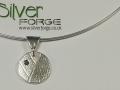 Scorpio silver and topaz pendant front view