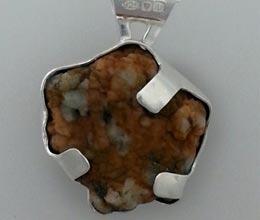 Granite pebble in silver