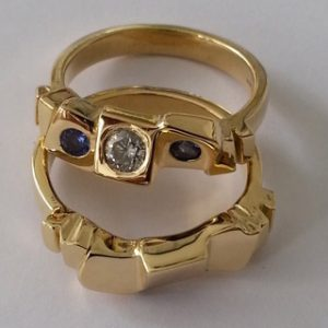 18kt yellow gold block rings with diamond and tanzanites