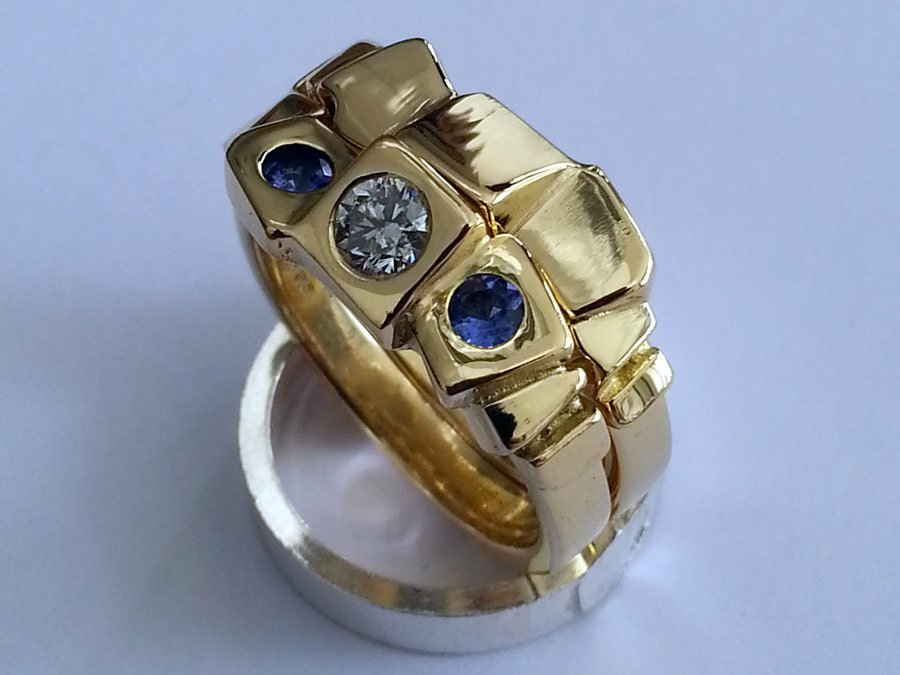 Diamond and tanzanite 18kt gold rings