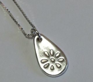 Fine silver flower embossed pendant on sterling silver box chain