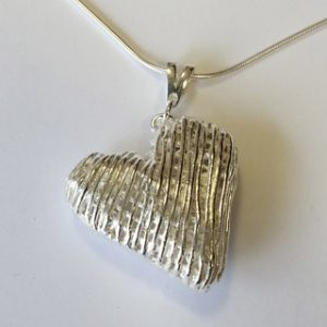 Fine silver hollow heart pendant with mobile triangular bail criss cross