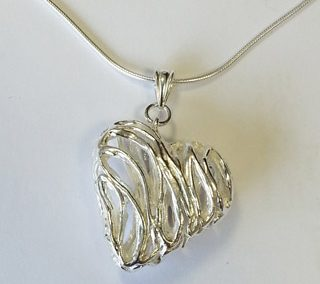 Fine silver hollow heart pendant with mobile triangular bail large loops