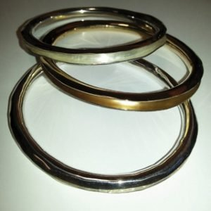 Sterling silver and 9kt yellow gold anticlastic bangles