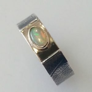 Sterling silver and 9kt yellow gold ring with opal focal point