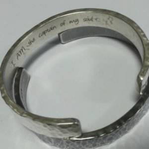 Sterling silver and laser engraved invictus cuffs 1