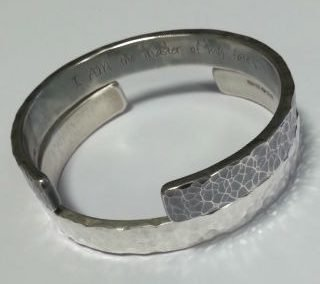 Sterling silver and laser engraved invictus cuffs