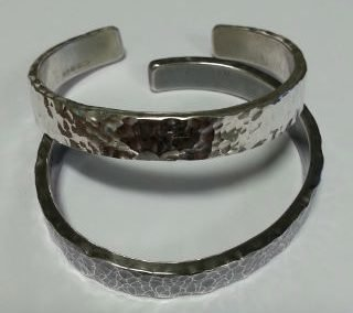 Sterling silver and laser engraved matching cuffs