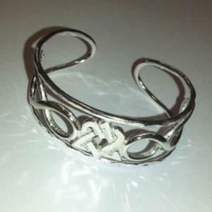 Sterling silver symbolic cuff
