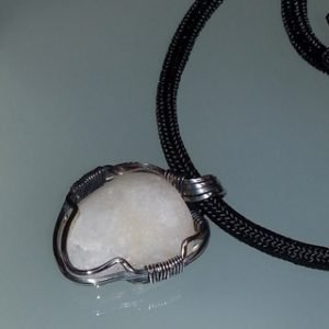 Sterling silver wrapped stone pendant