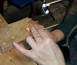 Hands of a student on the Jewellery Workshop