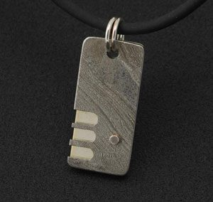 Men's pendant in sterling silver and stainless steel