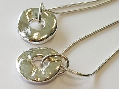 Close up of silver nugget pendant