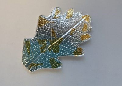 Silver leaf with gold foil pattern