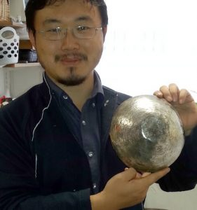 Student with his polished sterling silver rice bowl
